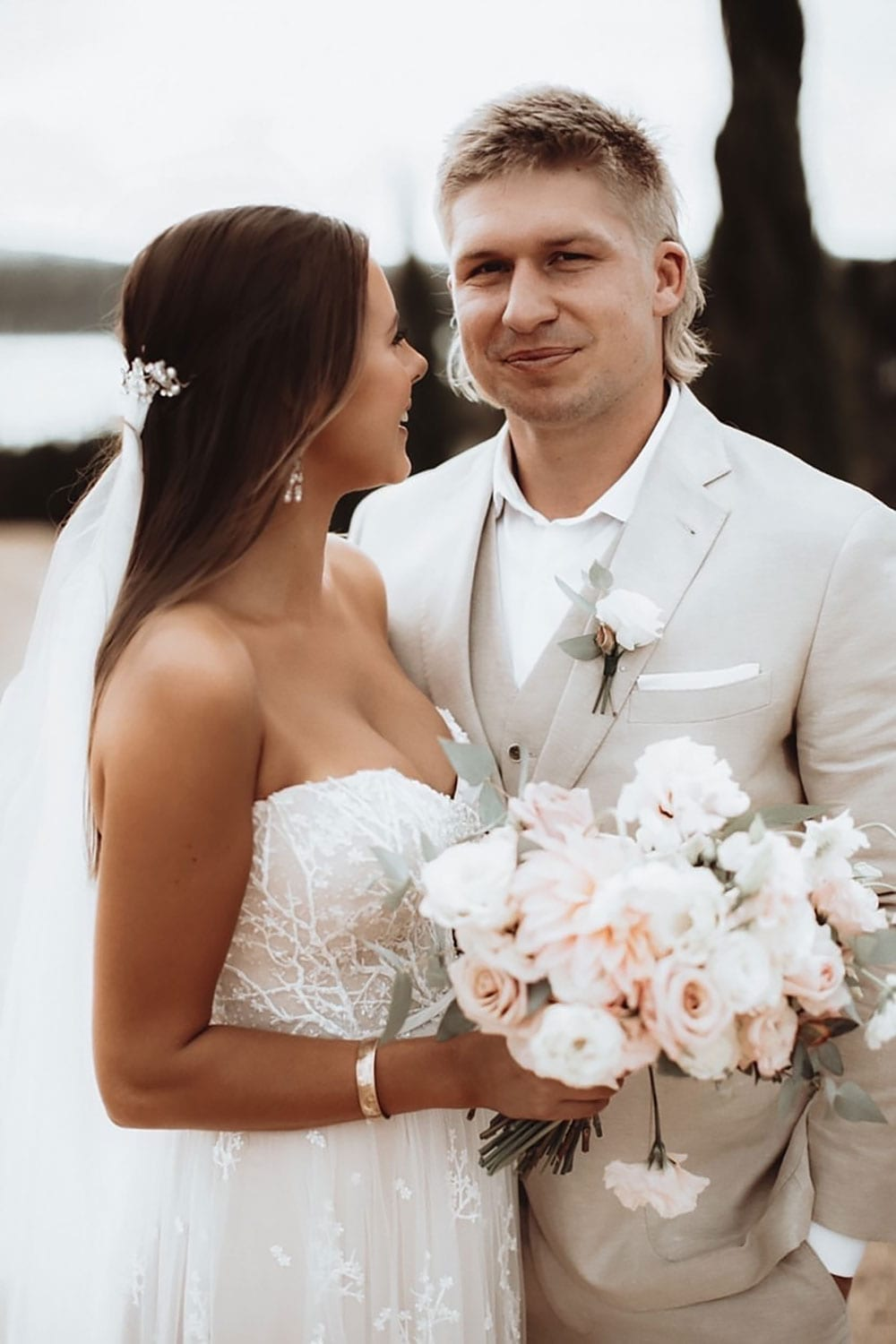 Vinka Design Features Real Weddings - custom made strapless beaded lace dress. Bride and groom