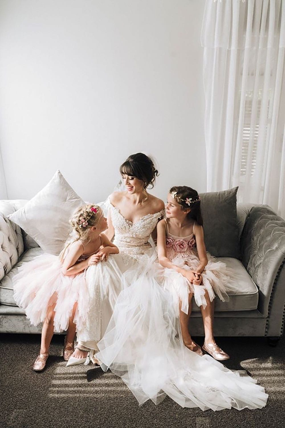 Vinka Design Features Real Weddings - bride wearing custom made beaded lace Sasha gown. Bride sitting with flower girls