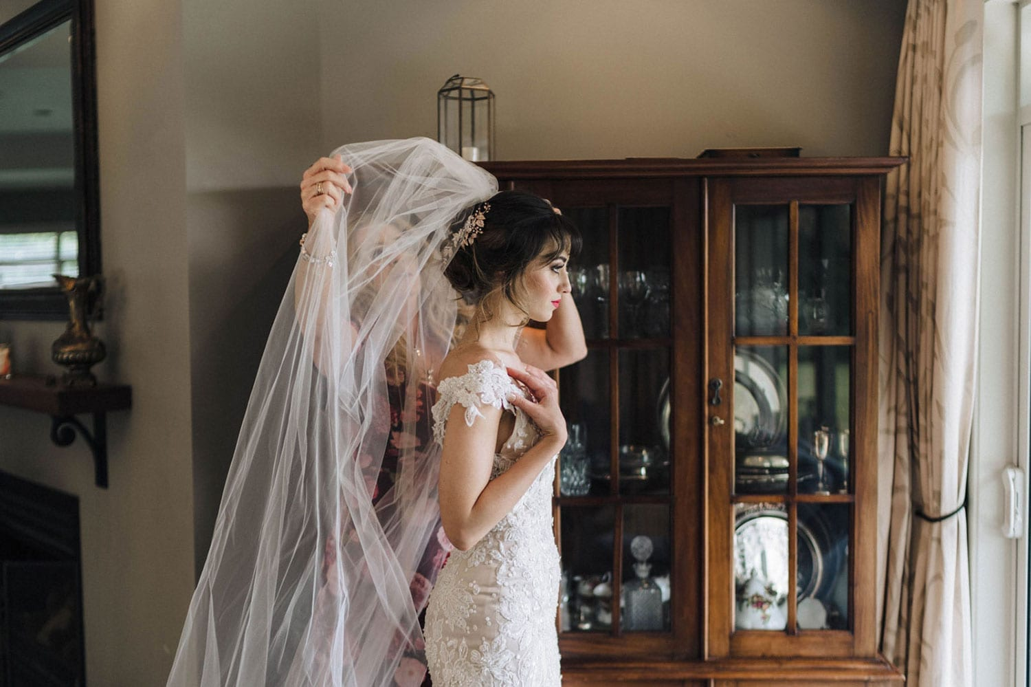 Vinka Design Features Real Weddings - bride wearing custom made beaded lace Sasha gown. Bride having veil attached