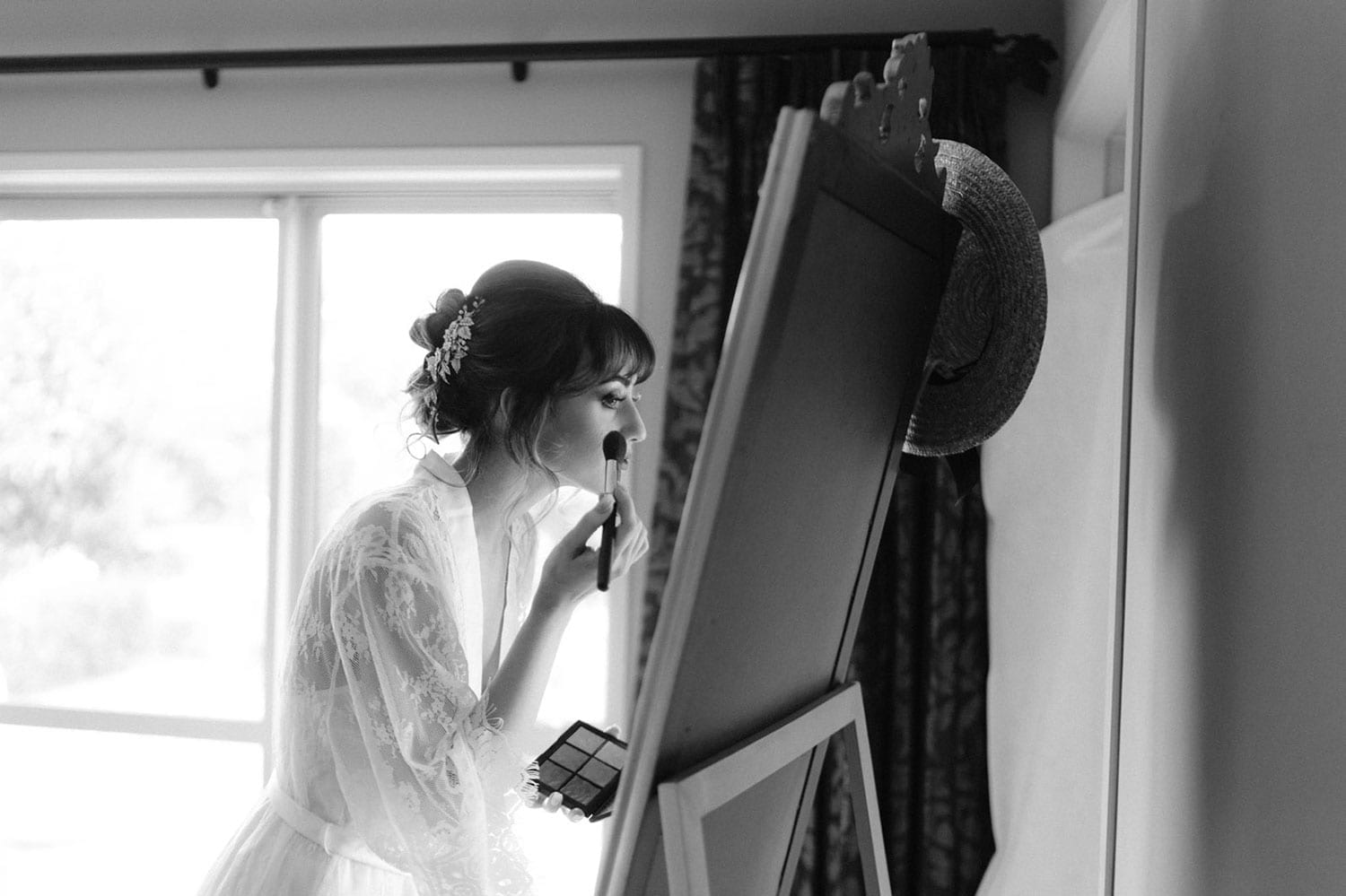 Vinka Design Features Real Weddings - bride wearing custom made beaded lace Sasha gown. Bride gets ready, putting on makeup