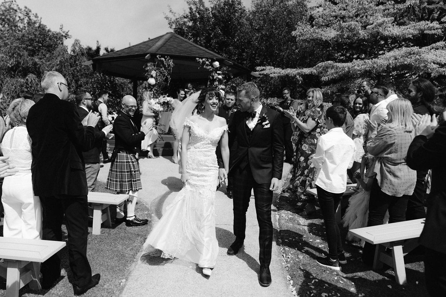 Vinka Design Features Real Weddings - bride wearing custom made beaded lace Sasha gown. Just married - in black and white