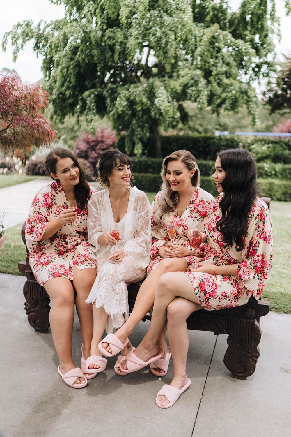 Vinka Design Features Real Weddings - bride wearing custom made beaded lace Sasha gown. Bride on morning of wedding with bridesmaids in floral robes