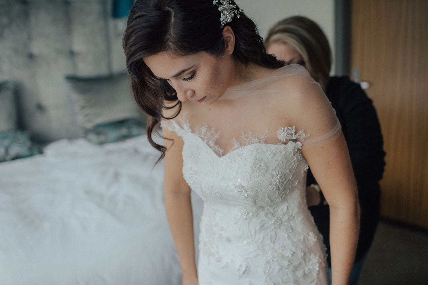 Vinka Design Features Real Weddings - bride wearing custom made lace wedding gown. Bride getting ready