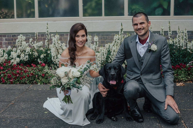 Vinka Design Features Real Weddings - bride wearing custom made lace wedding gown. Bride, groom and dog kneeling