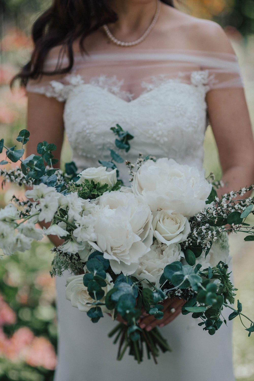 Vinka Design Features Real Weddings - bride wearing custom made lace wedding gown. Bouquet close up, dress detail