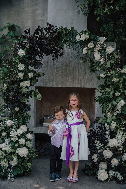 Vinka Design Features Real Weddings - children in flower arch