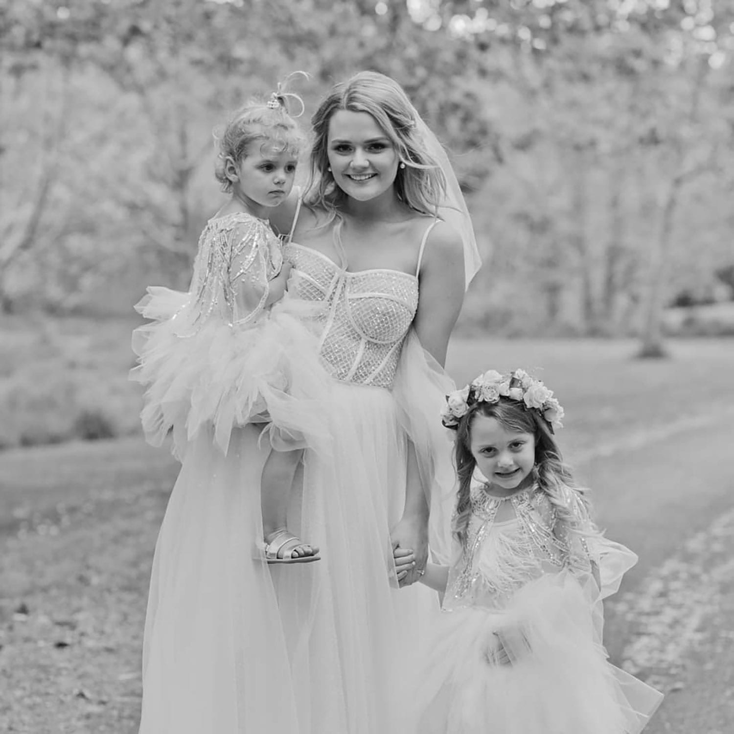 Vinka Design Features Real Weddings - bride wearing custom made gown with two different beadings incorporated into a fitted, structured bodice, and dreamy layered tulle skirt. Bride with children
