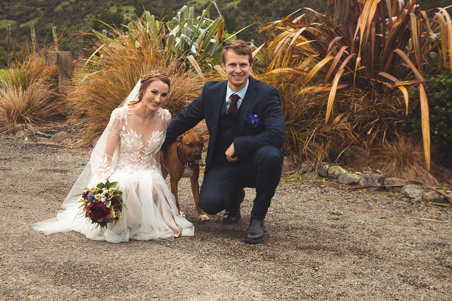 Vinka Design Features Real Weddings - bride in custom made gown, a combination of Isabelle and Ivy from our Heart of Havana collection. Bride and groom kneeling with dog