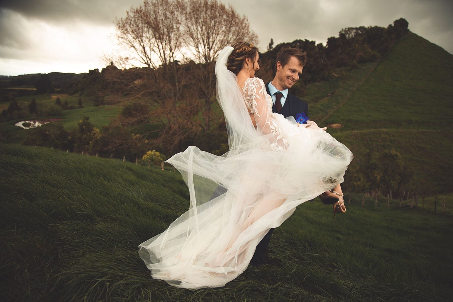 Vinka Design Features Real Weddings - bride in custom made gown, a combination of Isabelle and Ivy from our Heart of Havana collection. Groom carries bride