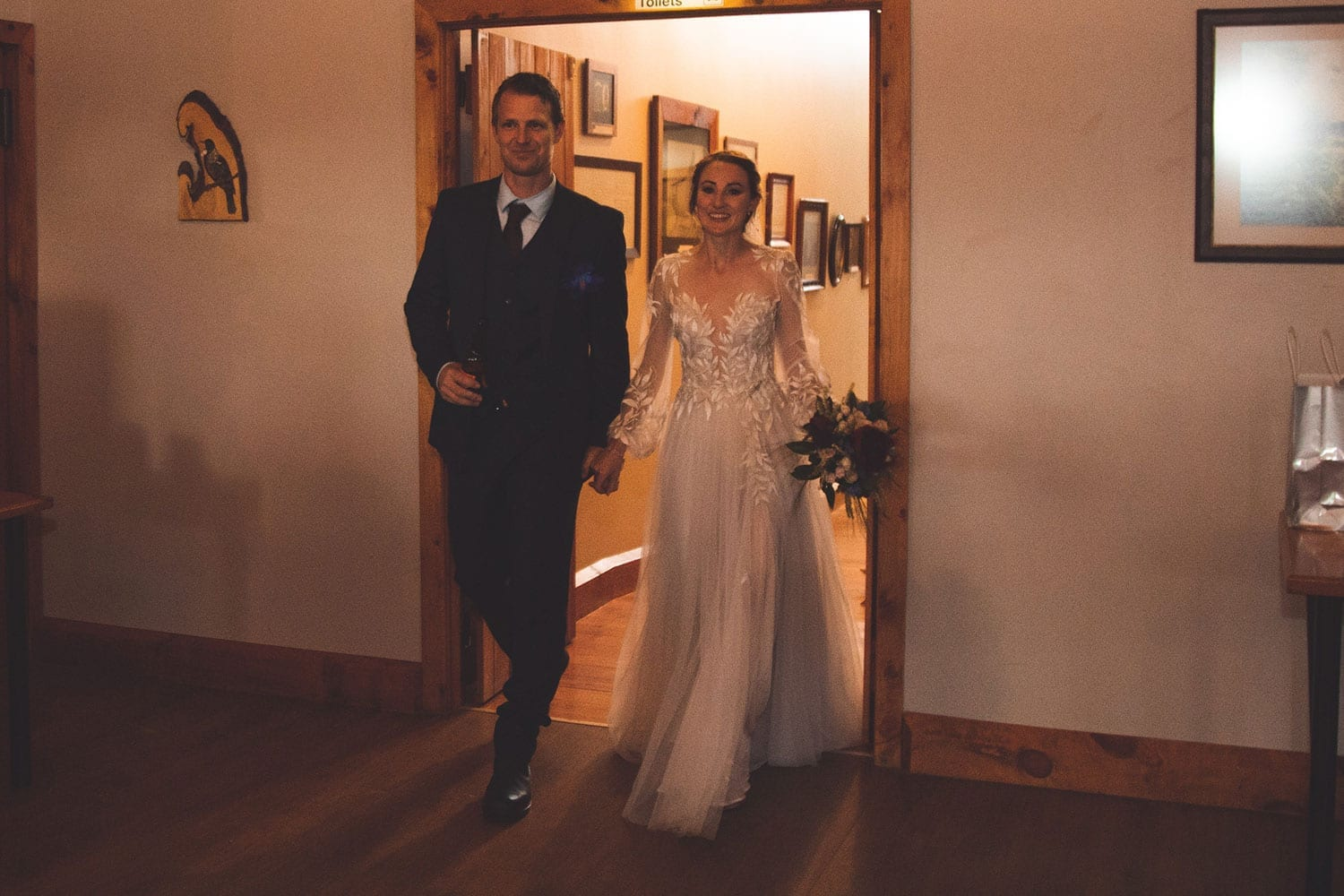 Vinka Design Features Real Weddings - bride in custom made gown, a combination of Isabelle and Ivy from our Heart of Havana collection. Bride and groom enter reception through doorway