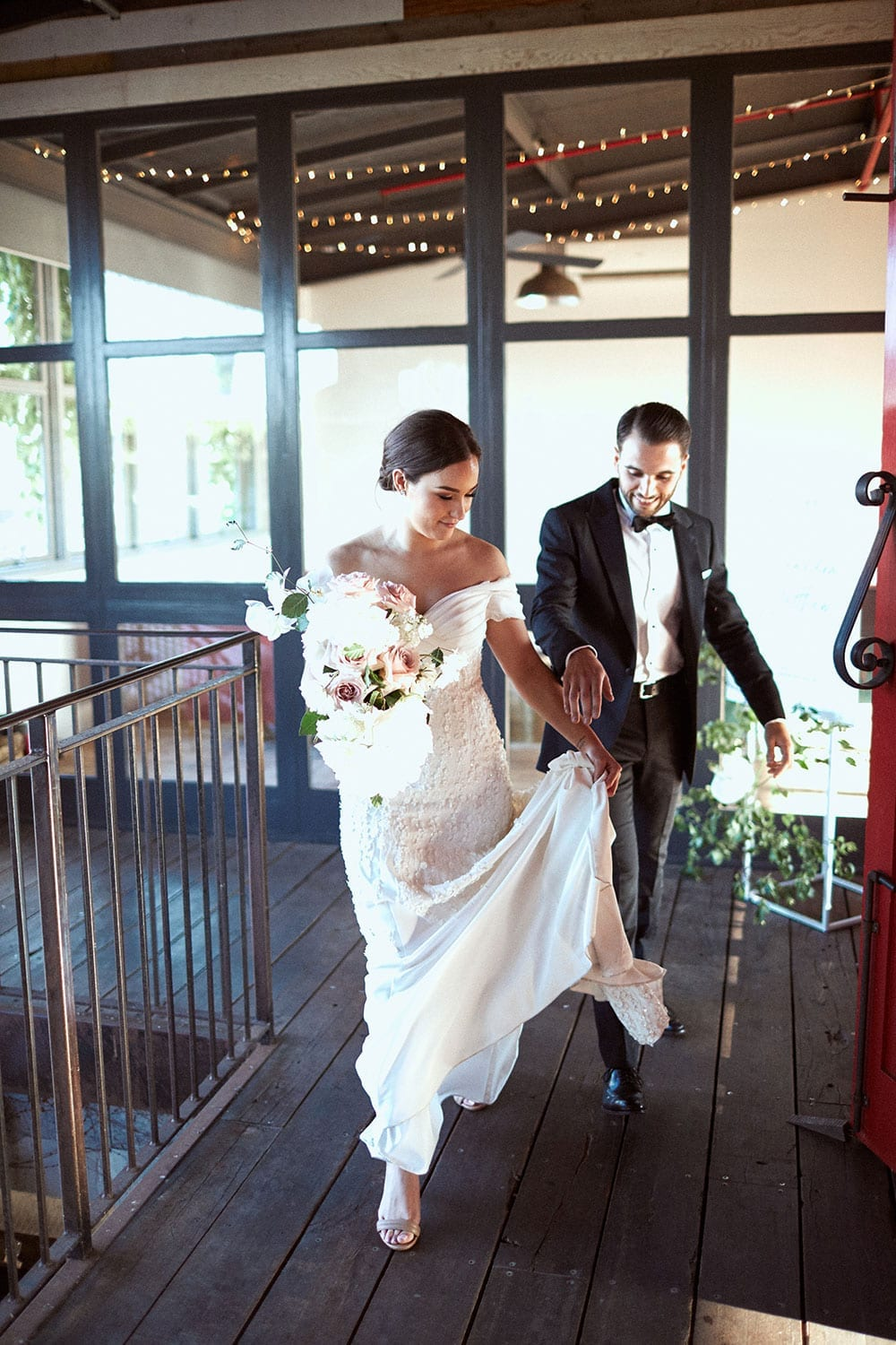 Vinka Design Features Real Weddings - bride in custom made gown with stunning silhouette and lace. Bride and groom enter reception