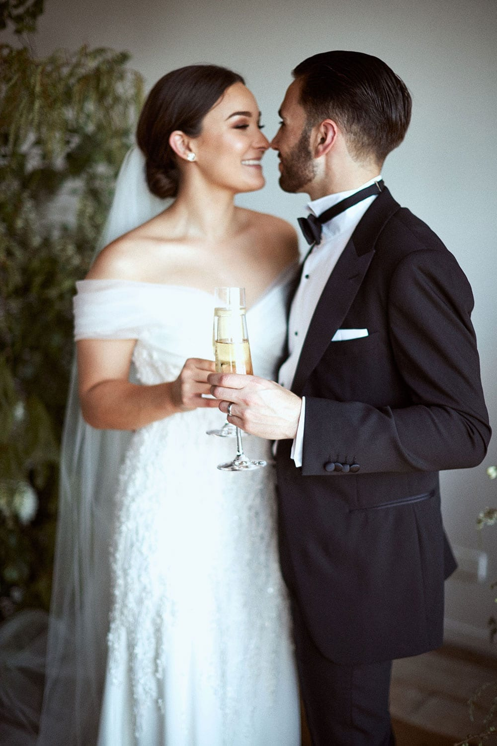 Vinka Design Features Real Weddings - bride in custom made gown with stunning silhouette with groom nose to nose