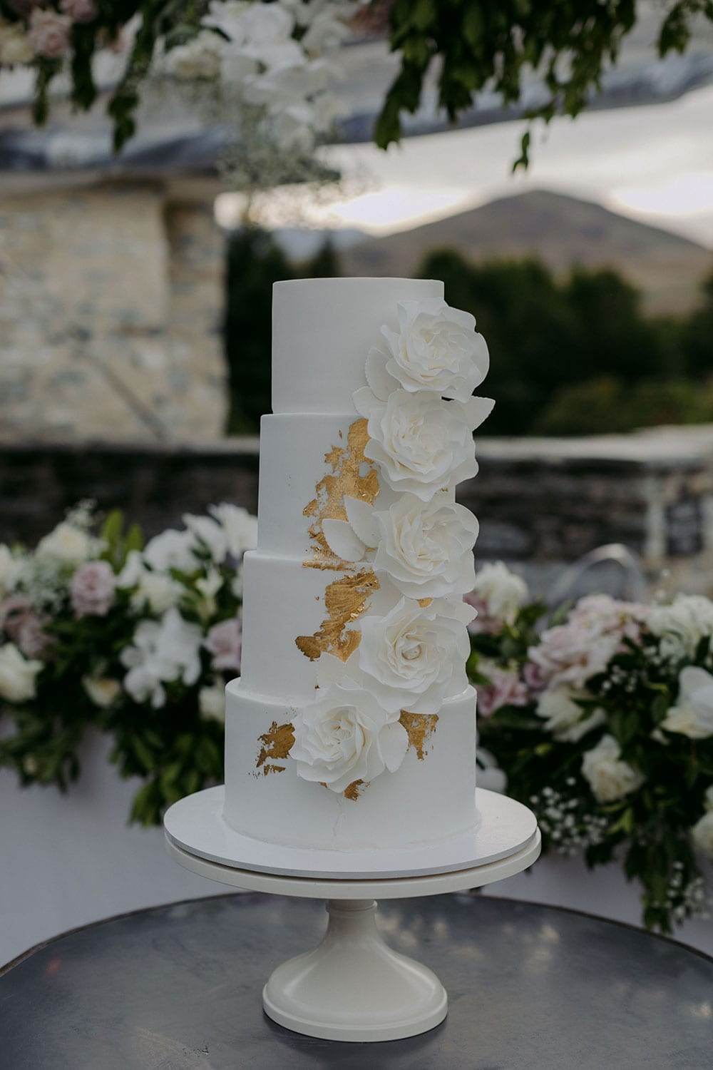 Vinka Design Features Real Weddings - wedding cake 4 tiers gold leaf white flowers