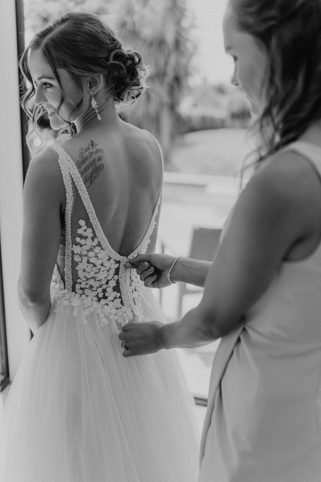 Vinka Design Features Real Weddings - bride in custom version of the Isabelle gown from our Heart of Havana collection. A fitted nude based bodice with delicate 3D beaded flowers with hand beaded trim and a skirt of dreamy tulle. Bride being fitted into dress