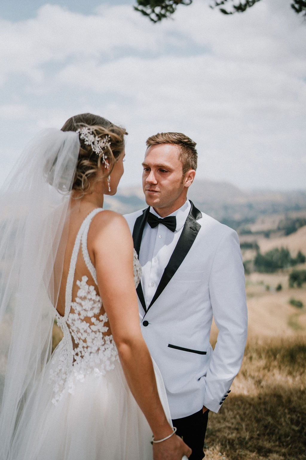 Vinka Design Features Real Weddings - bride in custom version of the Isabelle gown from our Heart of Havana collection. A fitted nude based bodice with delicate 3D beaded flowers with hand beaded trim and a skirt of dreamy tulle. Bride and groom face to face on panoramic mountain
