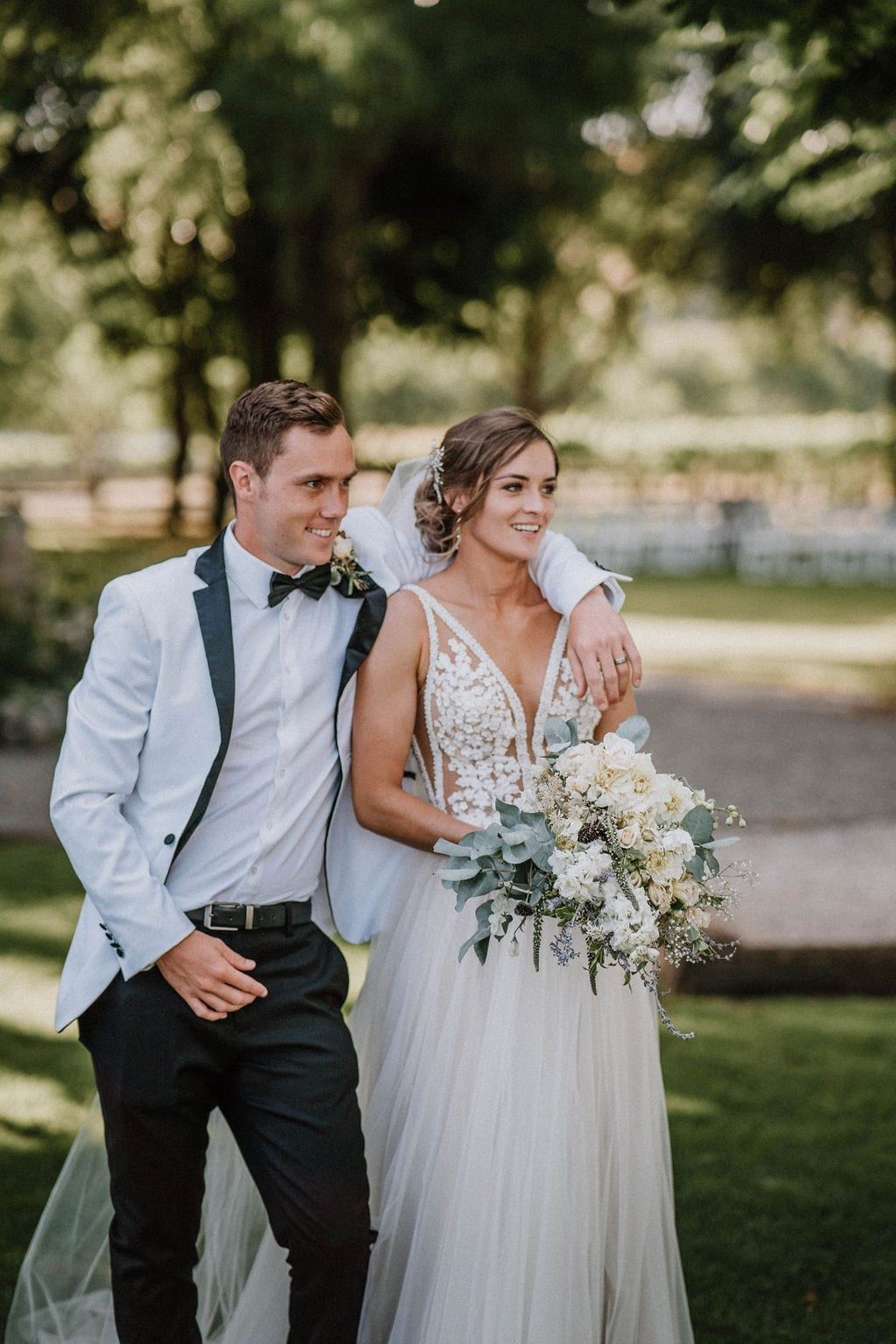 Vinka Design Features Real Weddings - bride in custom version of the Isabelle gown from our Heart of Havana collection. A fitted nude based bodice with delicate 3D beaded flowers with hand beaded trim and a skirt of dreamy tulle. Bride and groom pose