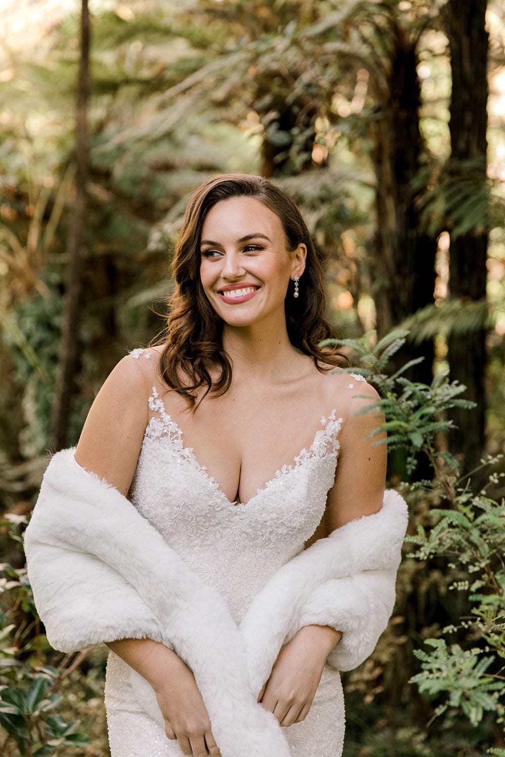 Dakota Wedding Dress from Vinka Design. This full-lace wedding dress is form fitting, sculpting the body beautifully. Delicate beaded lace flowers are hand-appliqued up the sheer nude tulle straps on both the front & back. Bodice with detail and snug, photographed at Tui Hills by Emmaline Photography.