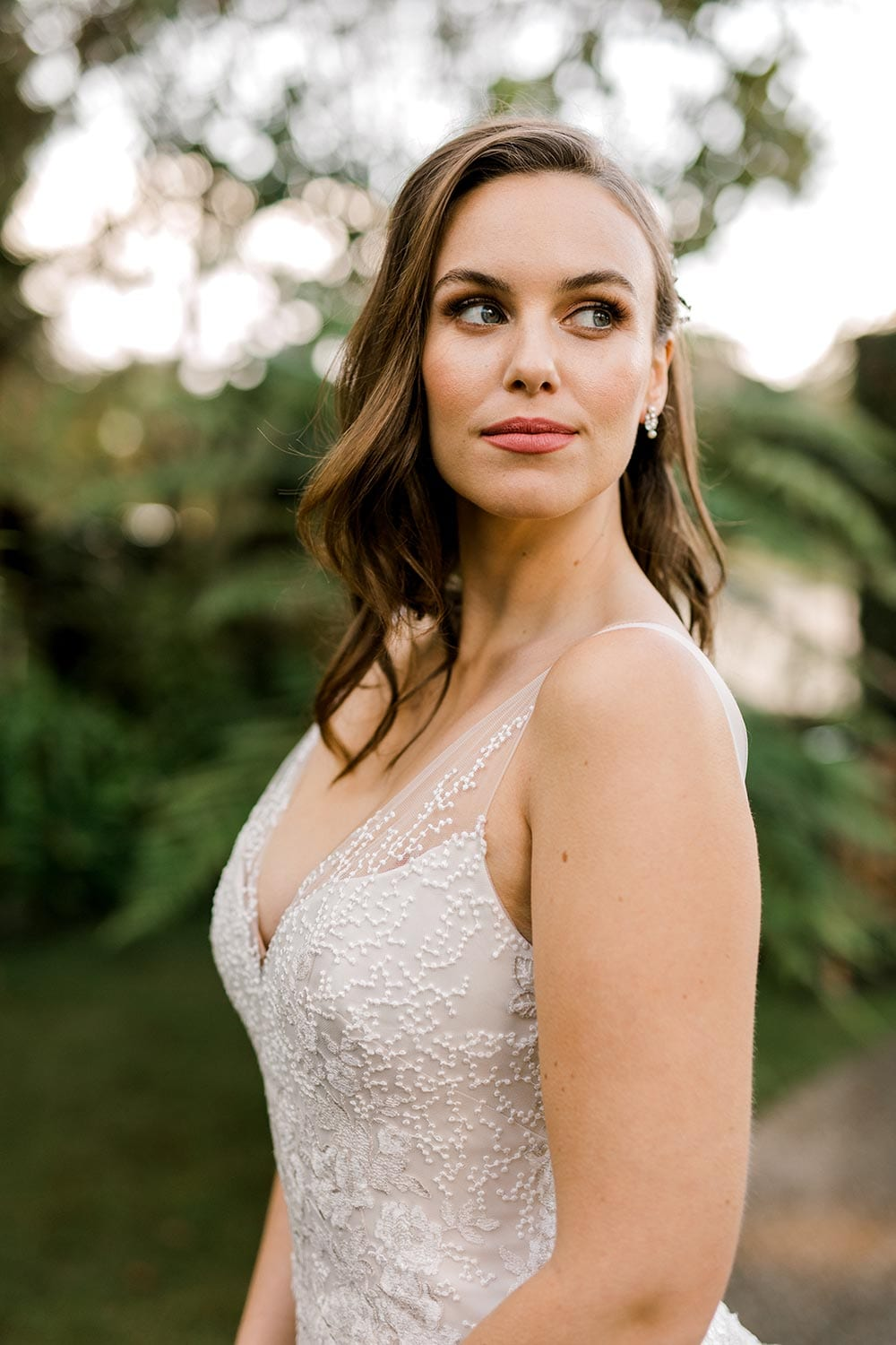 Hazel Wedding Dress from Vinka Design. Wedding dress with highly-sculptured bodice down to the hipline, at which point it gently flares into a beautiful and dreamy tulle skirt and train. Beautiful and delicate embroidery. Bodice detail from the side.