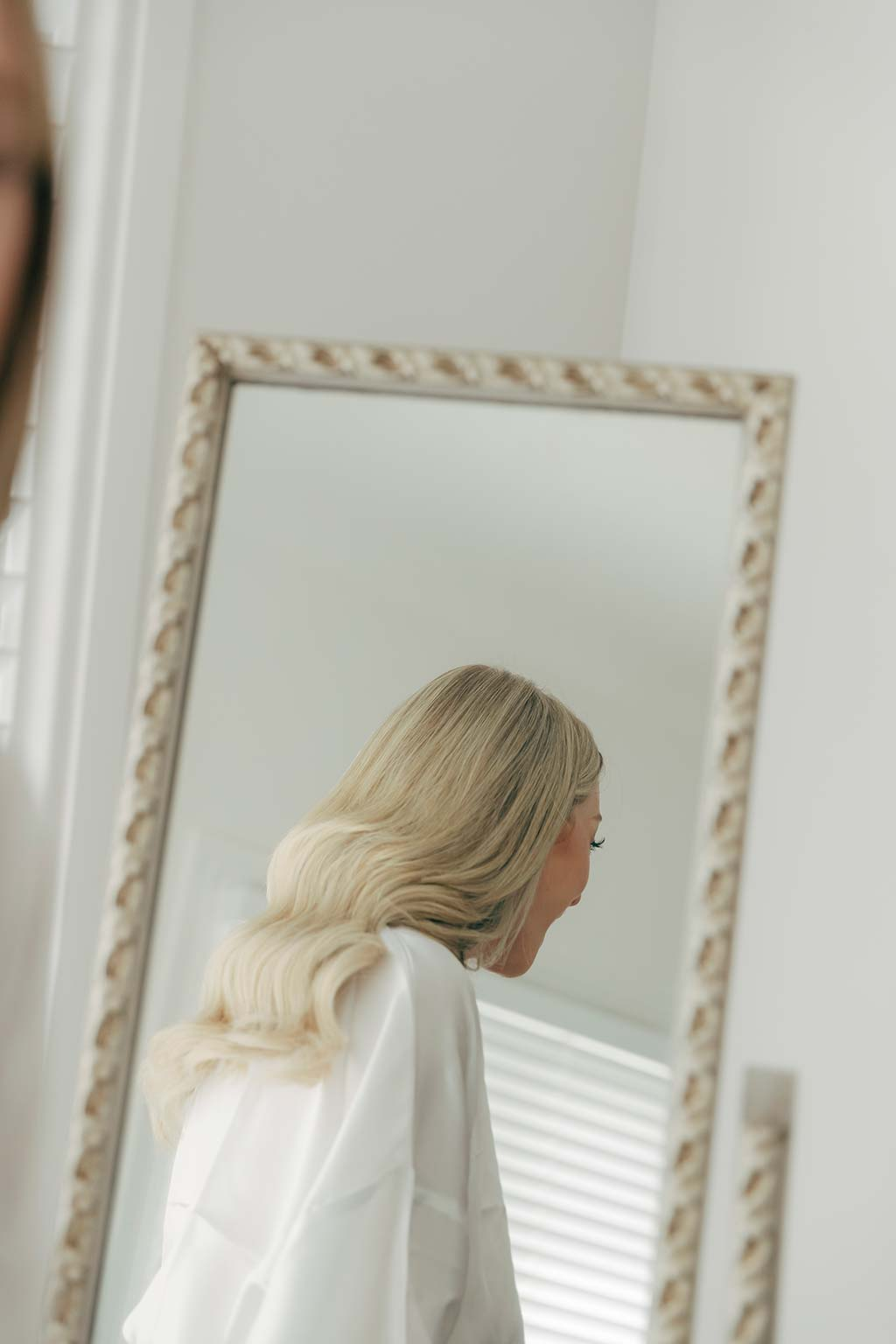 Vinka Design Bridal Wear features Real Wedding Matt and Emilia - Reflections of bride getting ready in the mirror
