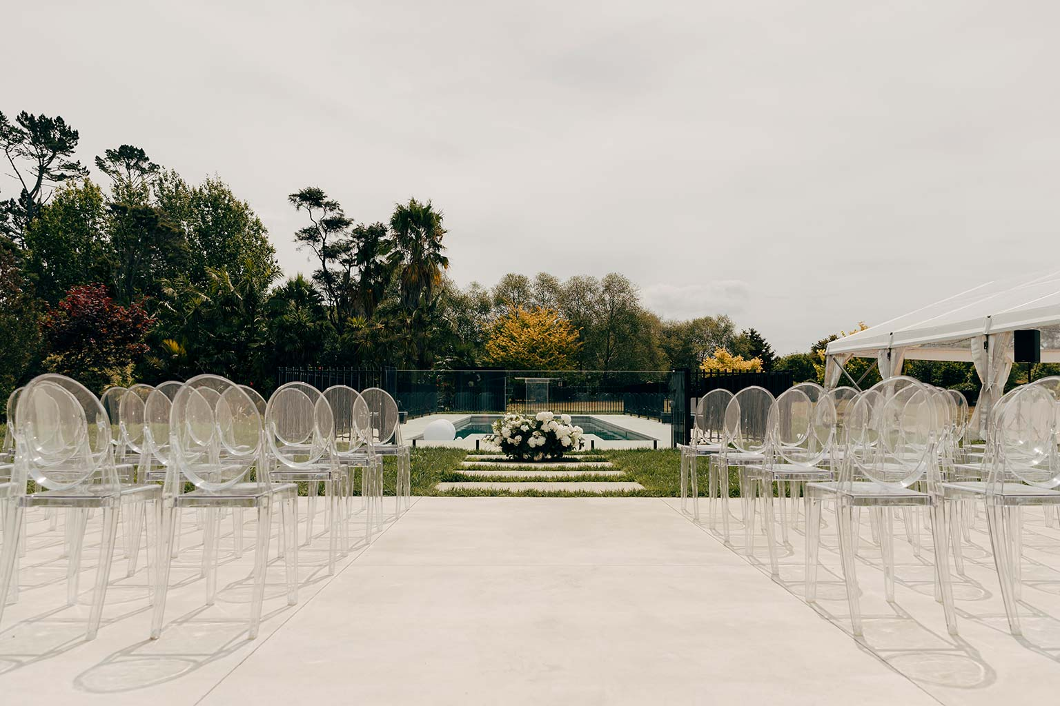 Vinka Design Bridal Wear features Real Wedding Matt and Emilia - outdoor ceremony with rows of empty chairs before guests arrive