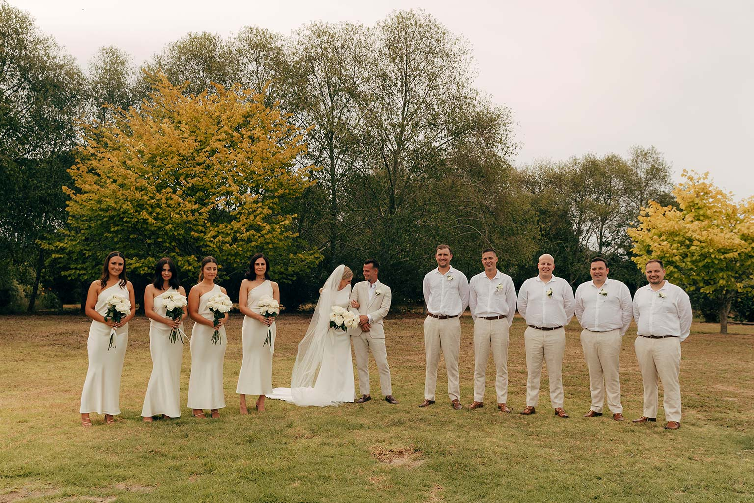 Vinka Design Bridal Wear features Real Wedding Matt and Emilia - bridal party pose, bride wearing stunning bespoke Audrey gown from Modern Muse Collection