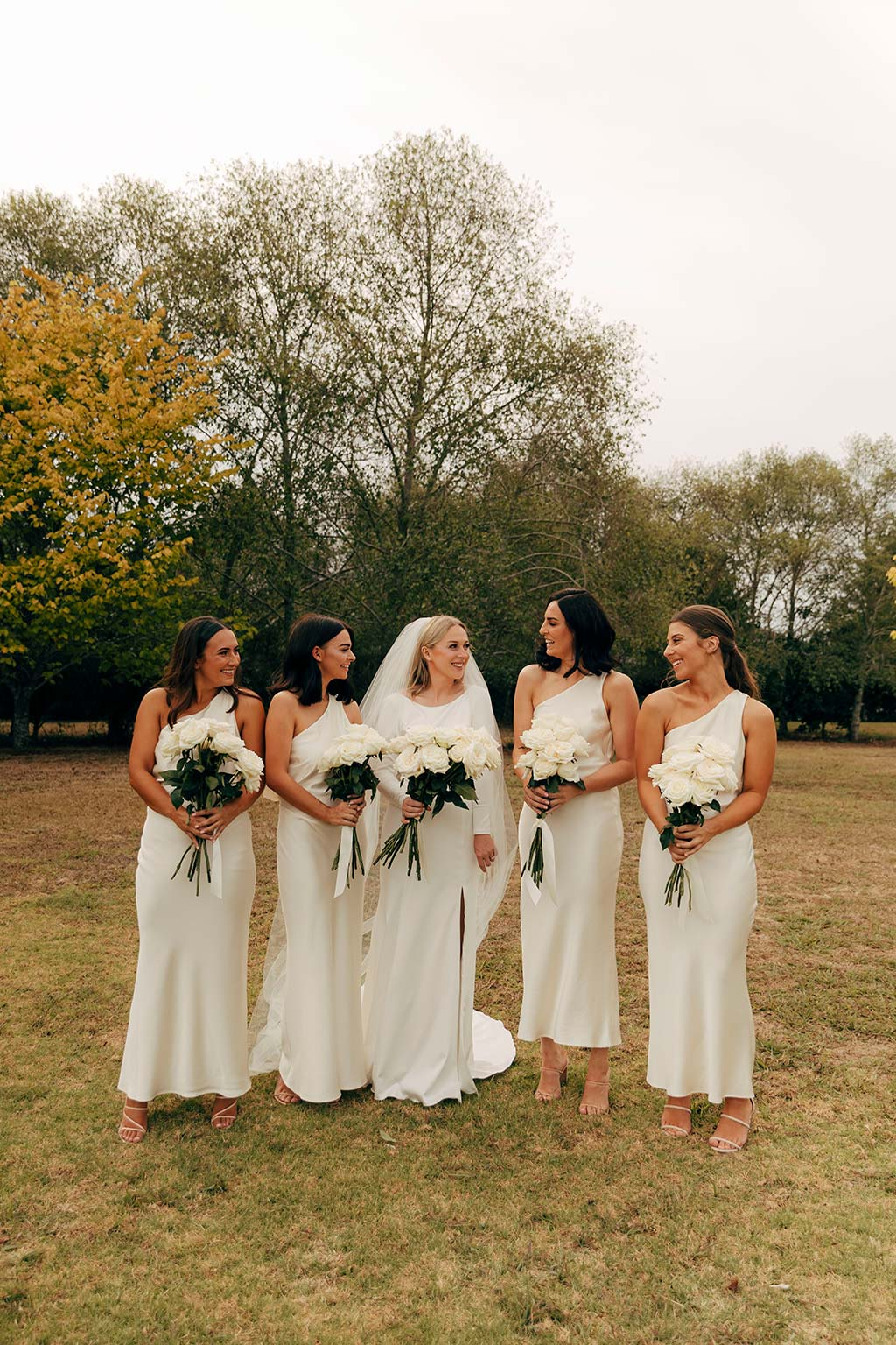 Vinka Design Bridal Wear features Real Wedding Matt and Emilia - bride and bridesmaids, bride wearing Audrey gown from Modern Muse Collection with long veil