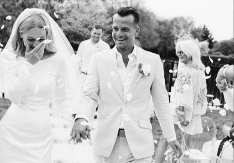 Vinka Design Bridal Wear features Real Wedding Matt and Emilia - bride and groom walk down aisle, bride wearing bespoke Audrey gown from Modern Muse Collection in black and white