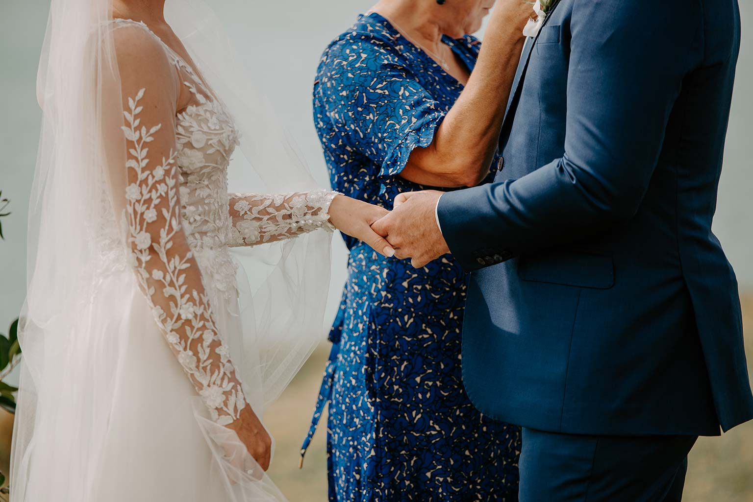 Vinka Design Features Real Weddings - bride and groom exchange rings - bride wearing a bespoke Makaira gown with silk-chiffon and tulle overskirt giving her a beautiful train which could be removed later on to reveal a floor length party dress