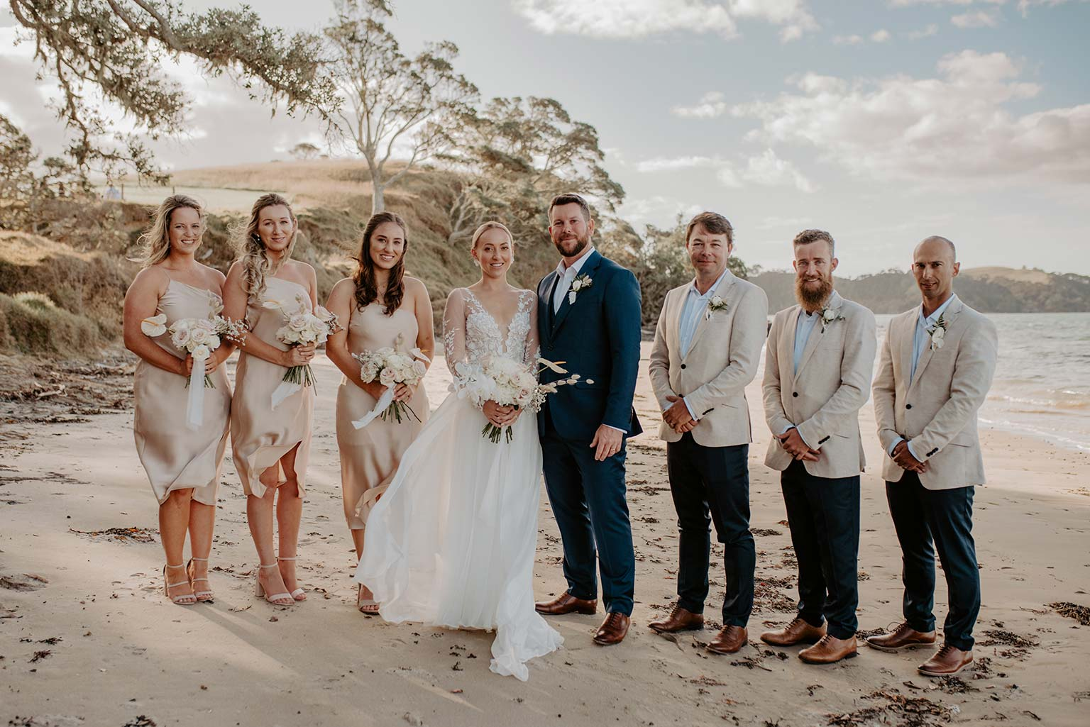 Vinka Design Features Real Weddings - bride and groom with bridesmaids and groomsmen - bride wearing a bespoke Makaira gown with silk-chiffon and tulle overskirt giving her a beautiful train which could be removed later on to reveal a floor length party dress