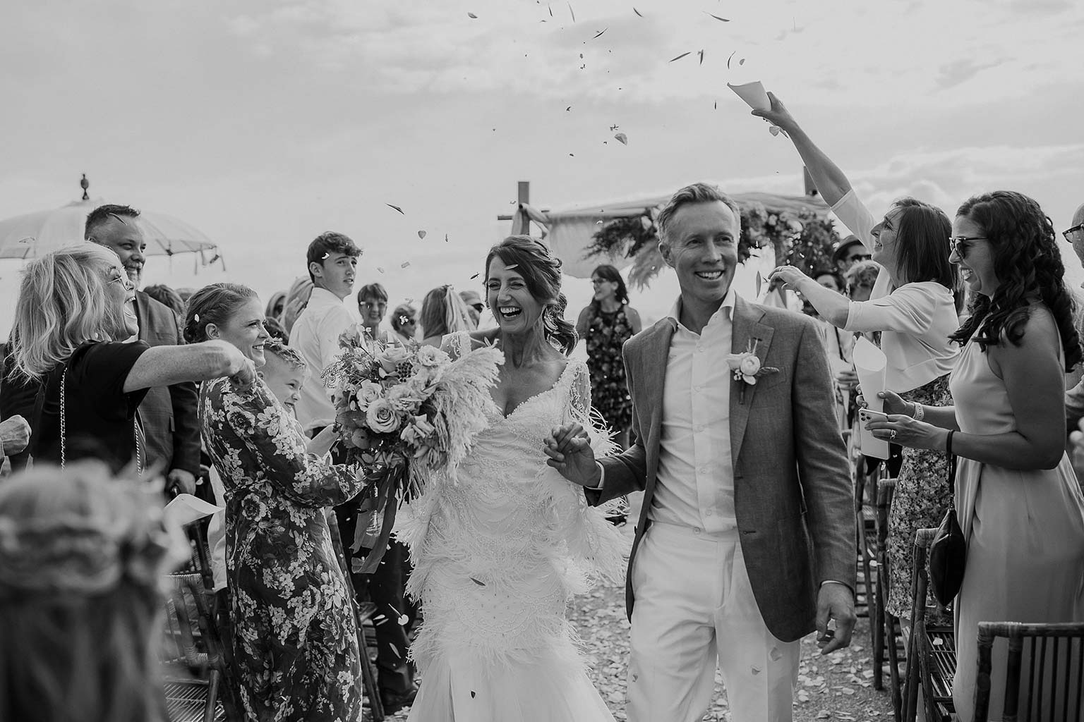 Vinka Design Features Real Weddings - bride and groom walk down aisle - bride wearing beautiful silk and tulle Chanel wedding dress from the Heart of Havana Collection with added underskirt - in black and white