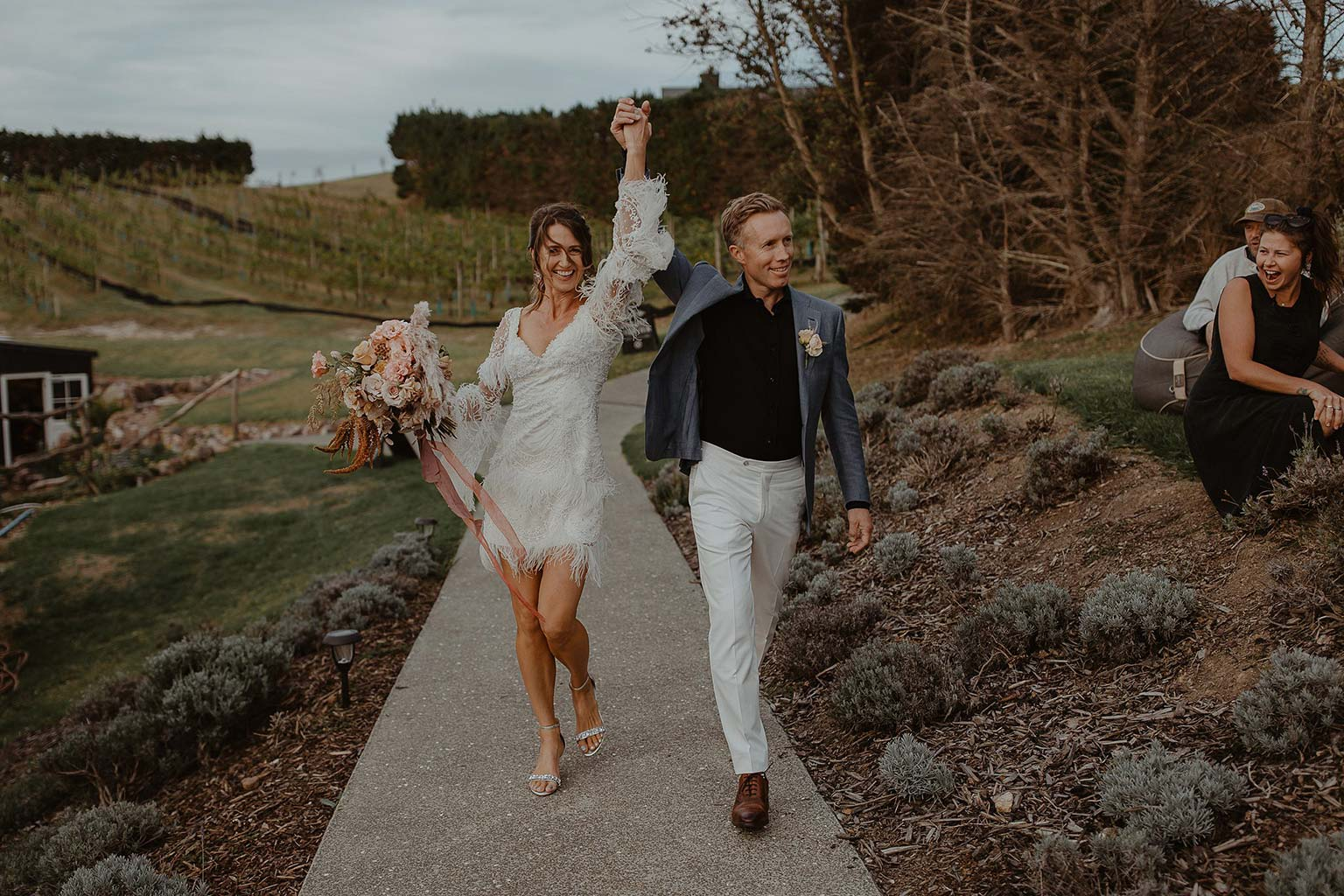 Vinka Design Features Real Weddings - bride and groom walk to reception - bride wearing beautiful silk and tulle Chanel wedding dress from the Heart of Havana Collection