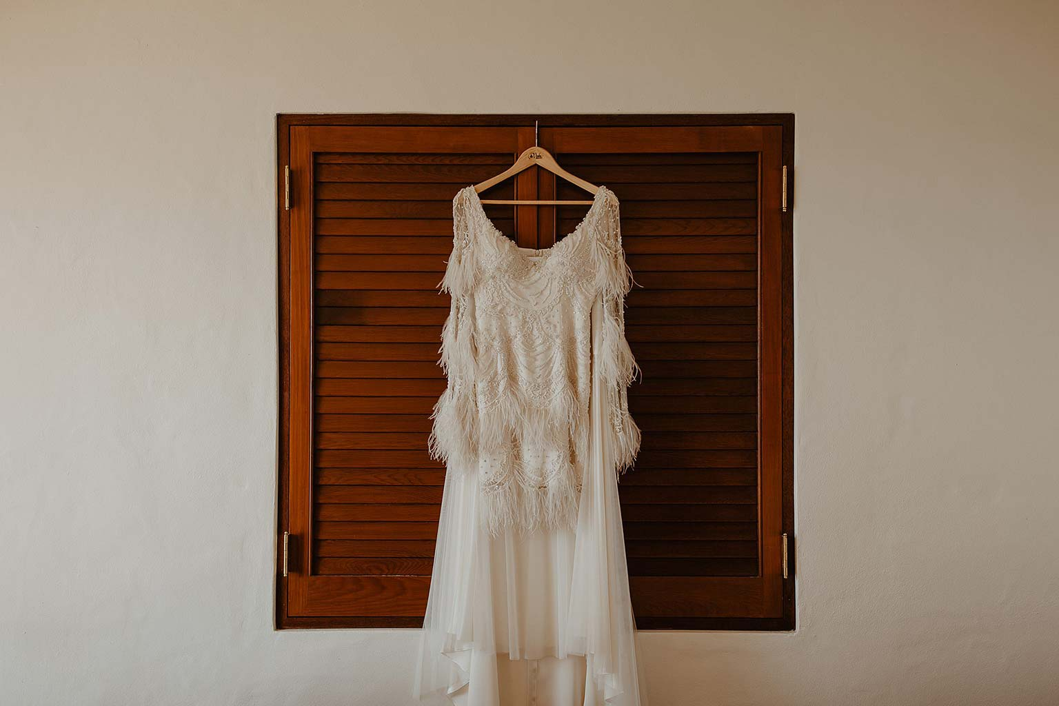 Vinka Design Features Real Weddings - beautiful silk and tulle Chanel wedding dress from the Heart of Havana Collection - dress hanging