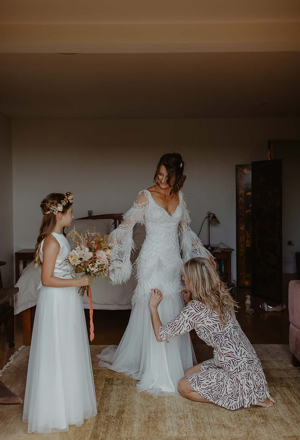 Vinka Design Features Real Weddings - bride getting ready - wearing beautiful silk and tulle Chanel wedding dress from the Heart of Havana Collection with added underskirt