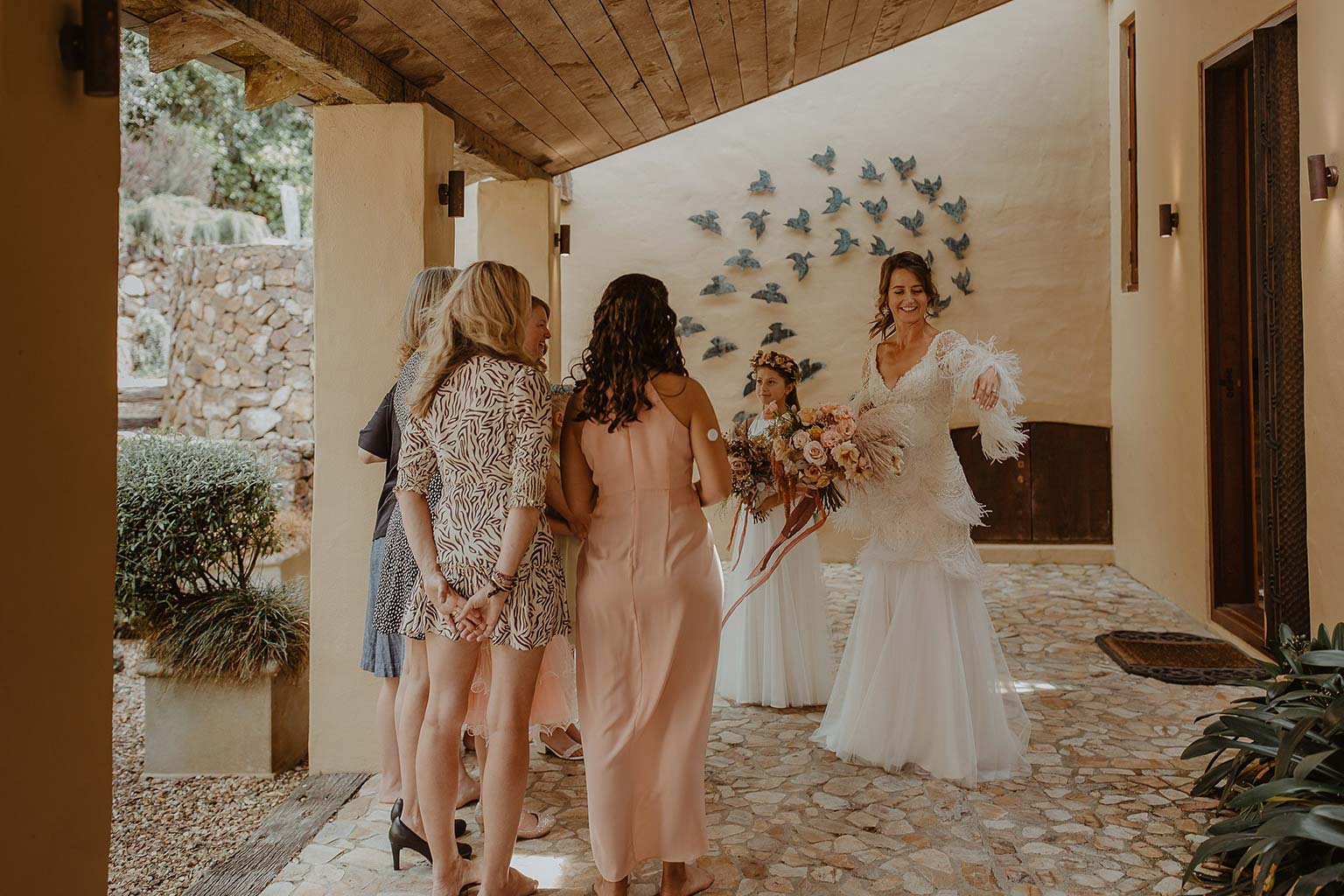 Vinka Design Features Real Weddings - bride with guests at wedding venue - bride wearing beautiful silk and tulle Chanel wedding dress from the Heart of Havana Collection with added underskirt