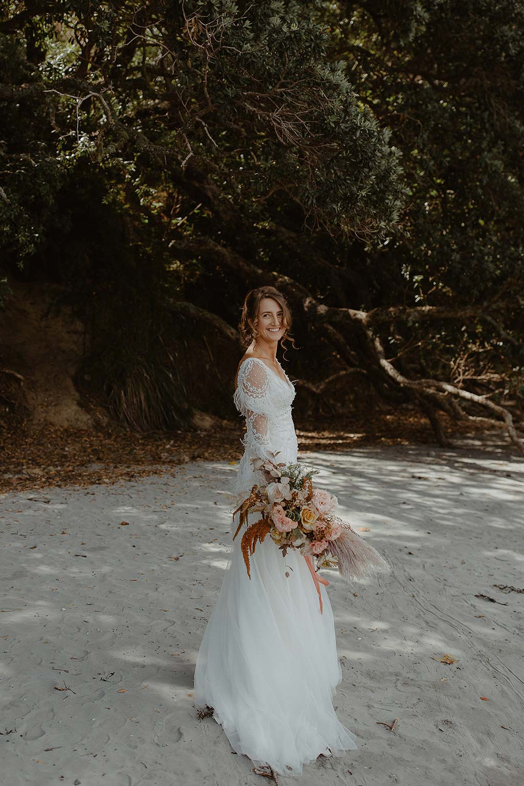 Vinka Design Features Real Weddings - bride wearing beautiful silk and tulle Chanel wedding dress from the Heart of Havana Collection with added underskirt