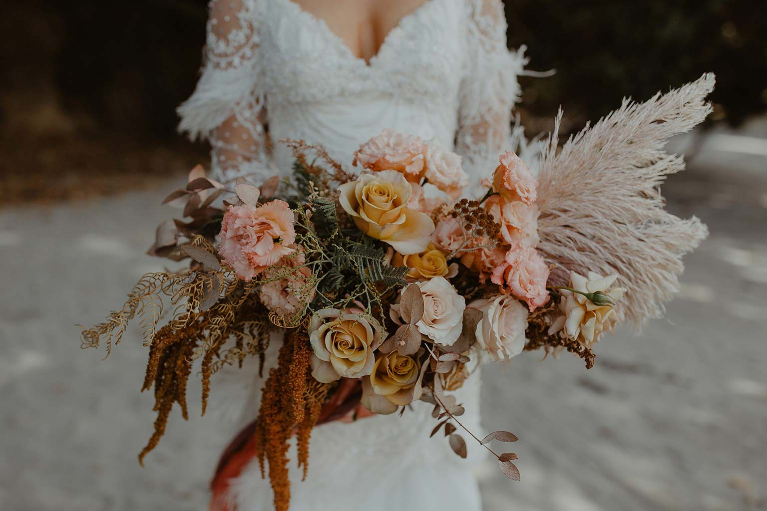 Vinka Design Features Real Weddings - bride wearing beautiful silk and tulle Chanel wedding dress from the Heart of Havana Collection with added underskirt posing with flower bouquet