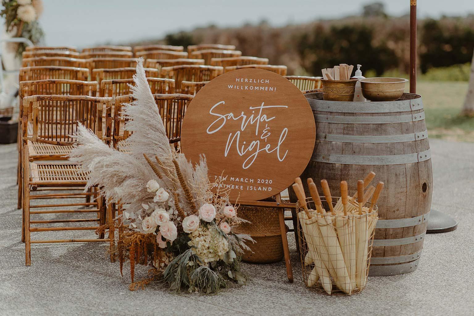 Vinka Design Features Real Weddings - wedding welcome board and seating at Mudbrick Vineyard