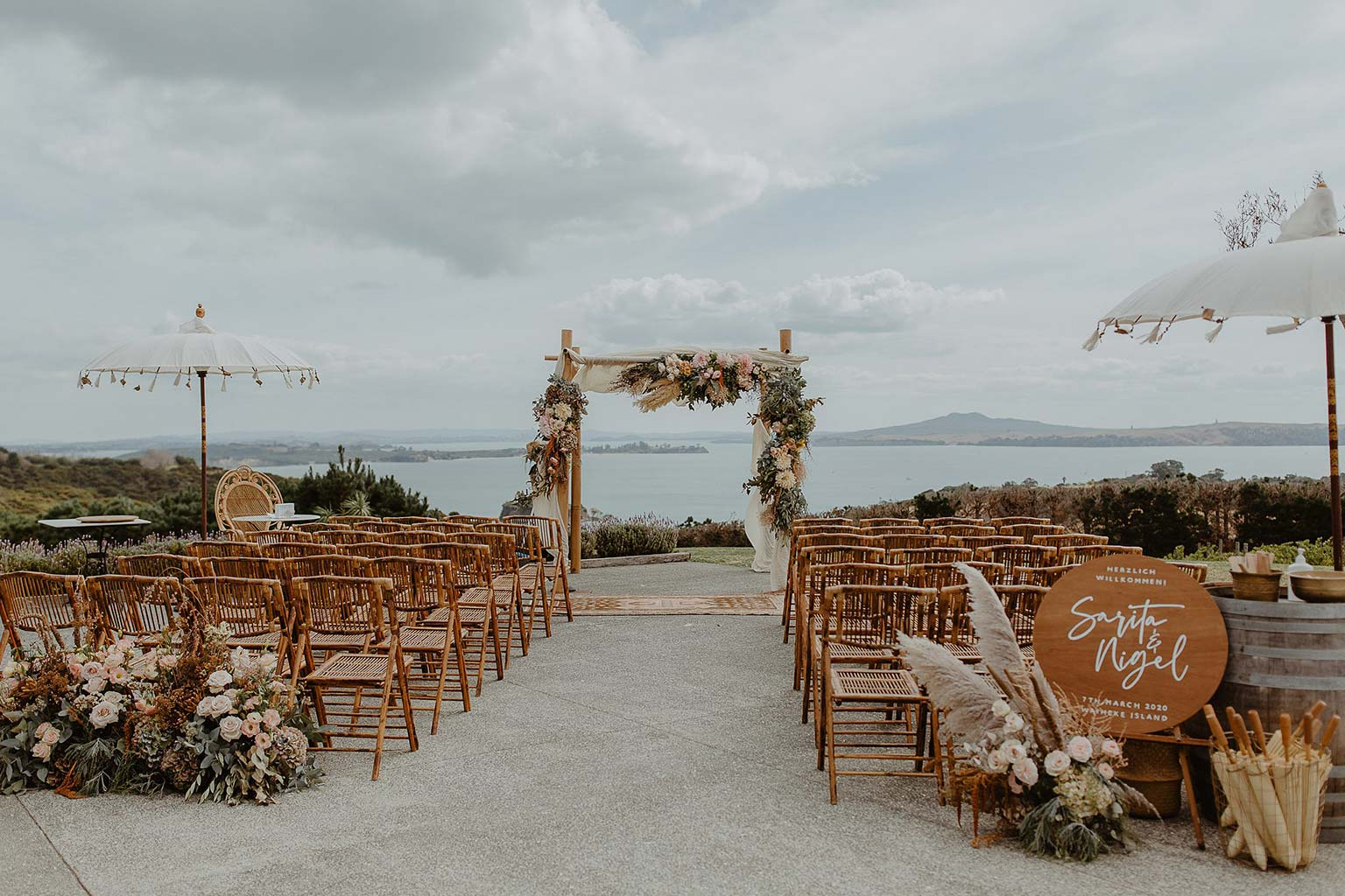 Vinka Design Features Real Weddings - wedding ceremony venue with outdoor benches and flowers at Mudbrick Vineyard