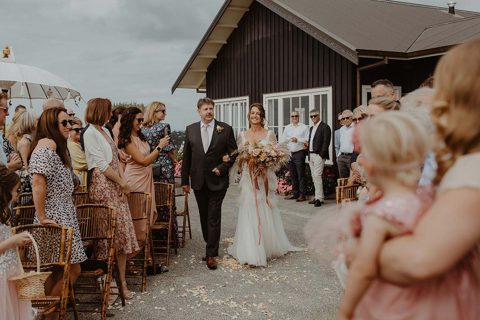Vinka Design Features Real Weddings - bride and groom walk down aisle - bride wearing beautiful silk and tulle Chanel wedding dress from the Heart of Havana Collection with added underskirt