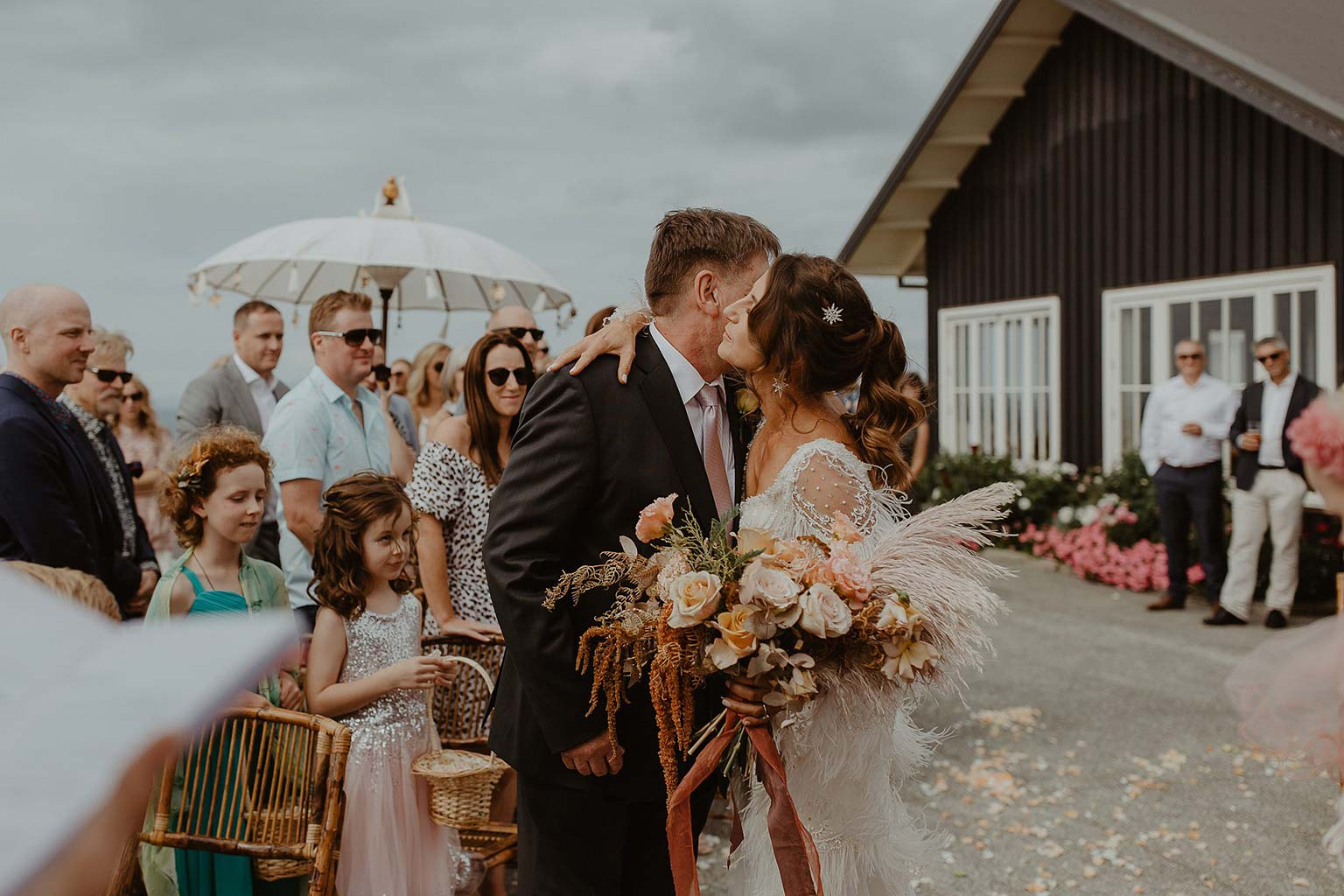 Vinka Design Features Real Weddings - bride and groom kiss - bride wearing beautiful silk and tulle Chanel wedding dress from the Heart of Havana Collection with added underskirt