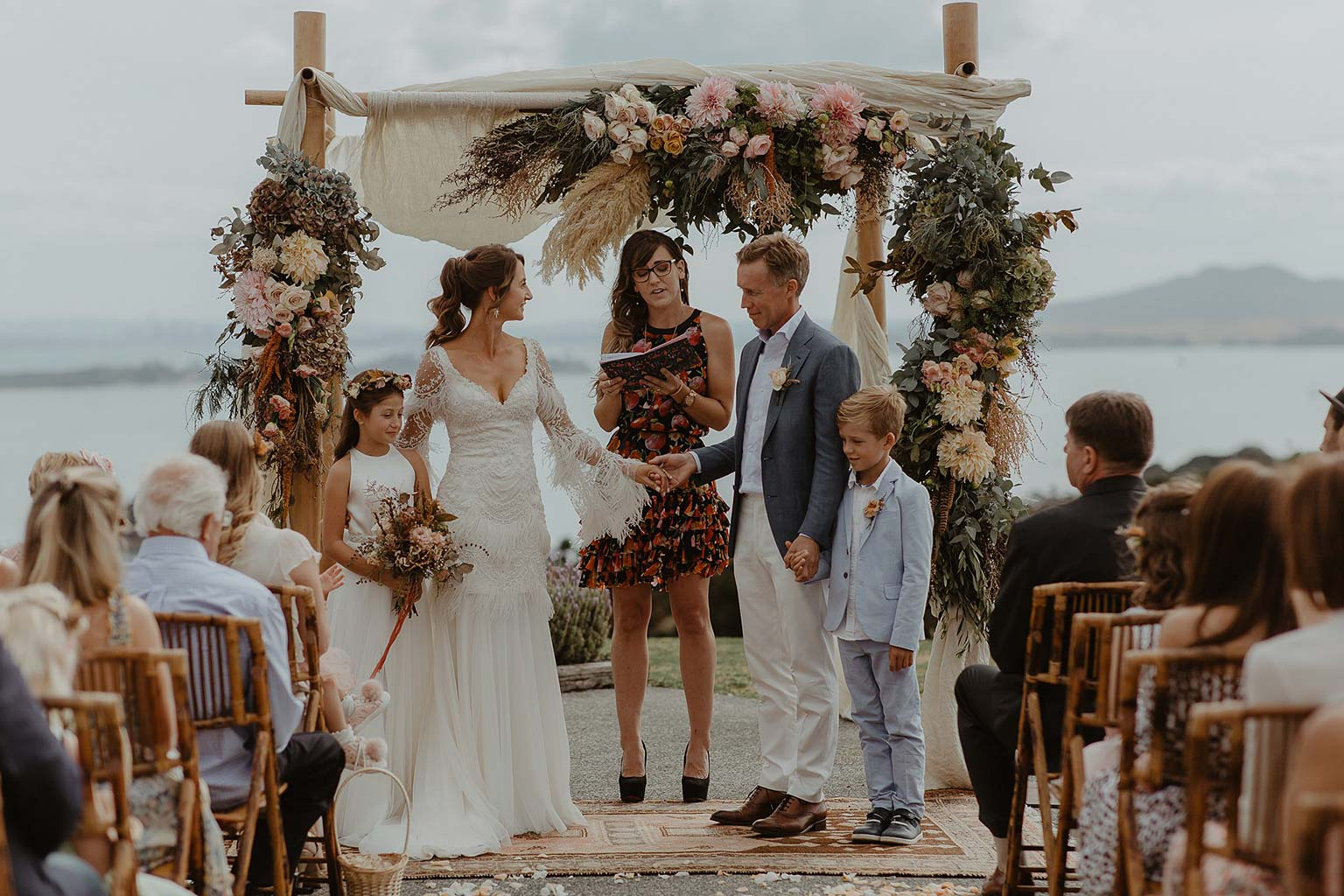 Vinka Design Features Real Weddings - bride and groom say vows - bride wearing beautiful silk and tulle Chanel wedding dress from the Heart of Havana Collection with added underskirt