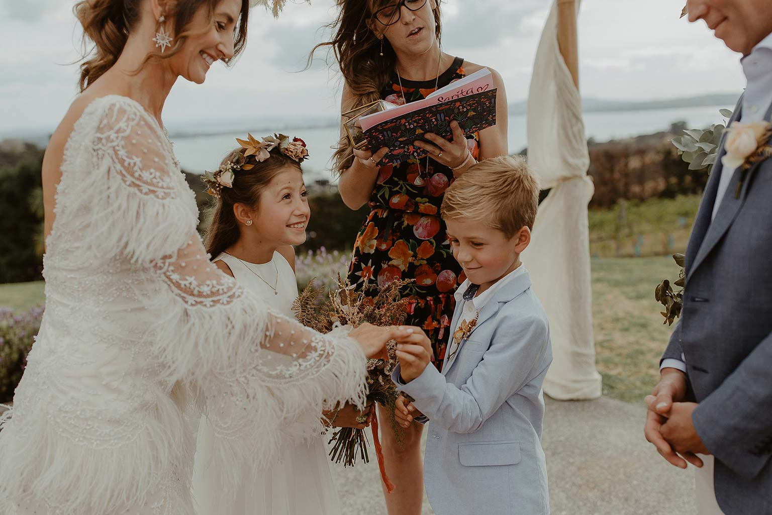 Vinka Design Features Real Weddings - wedding ceremony with flower girl and page boy - bride wearing beautiful silk and tulle Chanel wedding dress from the Heart of Havana Collection with added underskirt