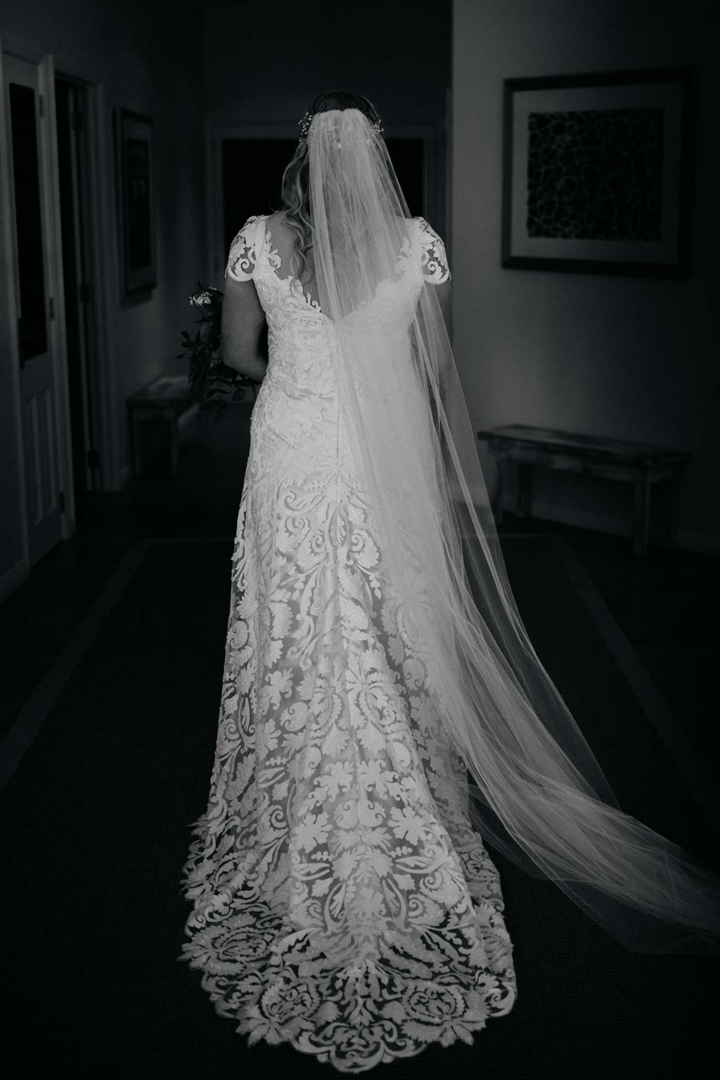 Vinka Design Features Real Weddings - bride wearing bespoke Vinka wedding gown - back of dress with lace detail and train