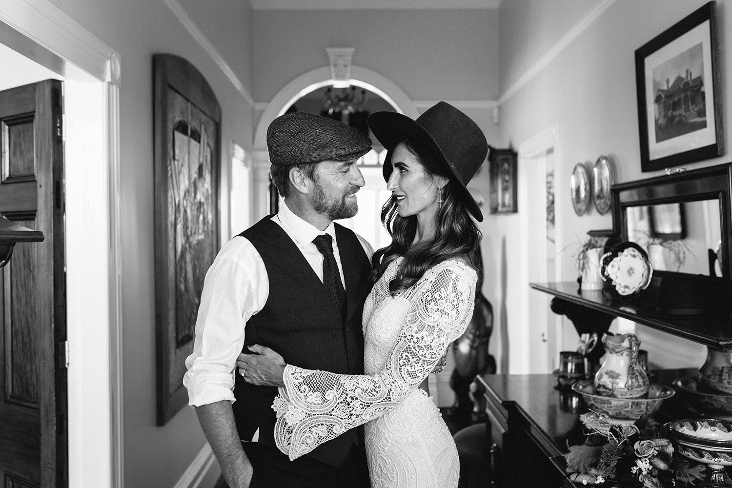 Bride wearing Sabine wedding gown by Auckland wedding dress maker Vinka Design, with French crochet lace detail and long sleeves - black and white profile