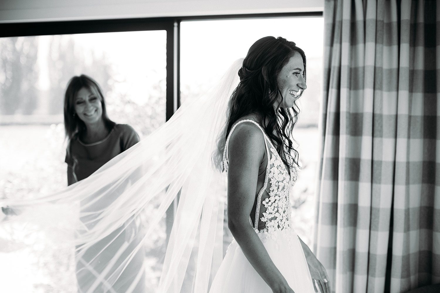Bride wearing Vinka bridal boutique Isabelle tulle gown with sheer v neck bodice and beaded lace - fitting veil