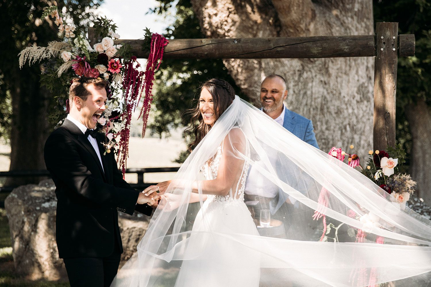 Bride wearing Vinka bridal boutique Isabelle tulle gown with sheer v neck bodice and beaded lace - with groom