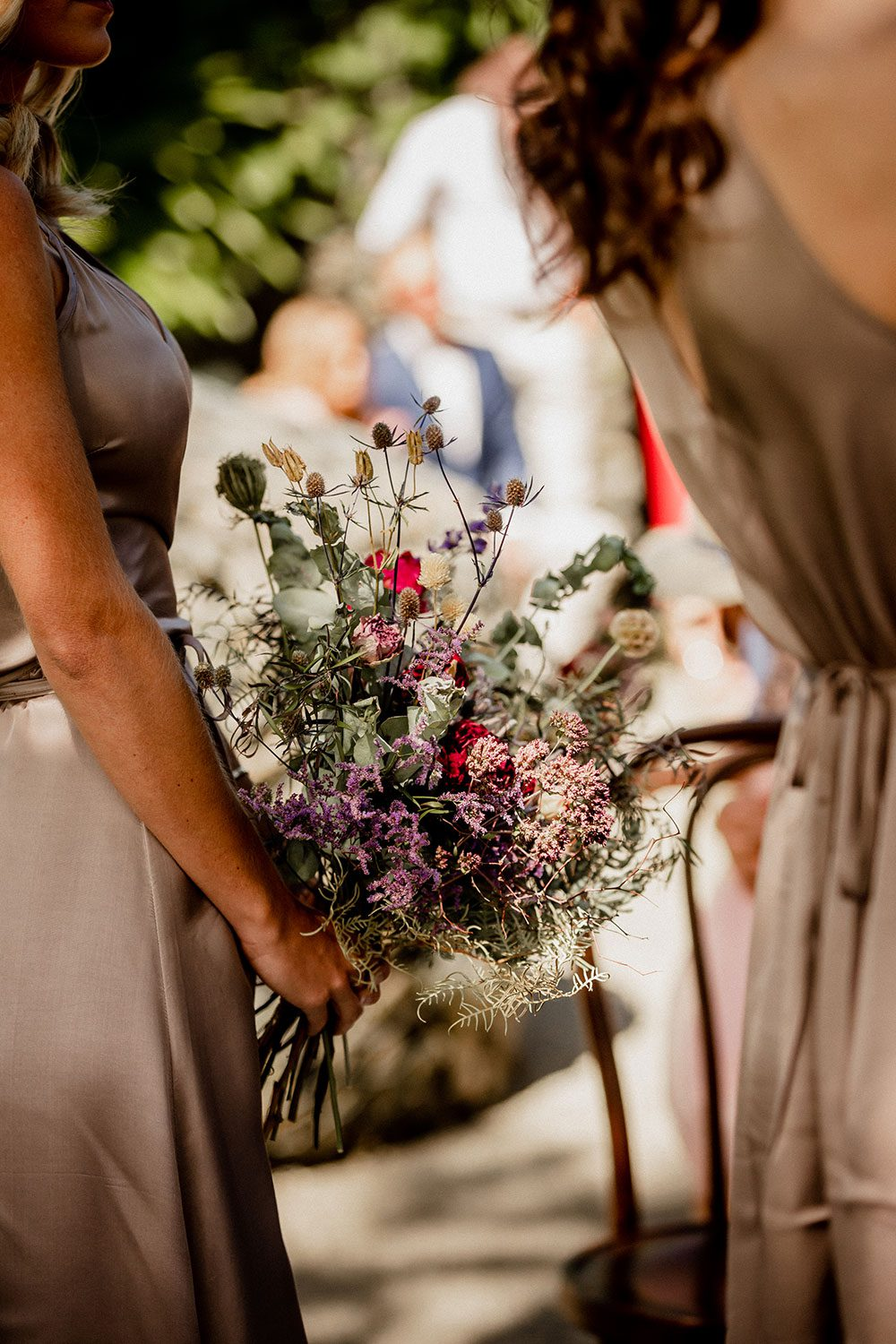 Emore and Hamish - Bridesmaid holding bouquet
