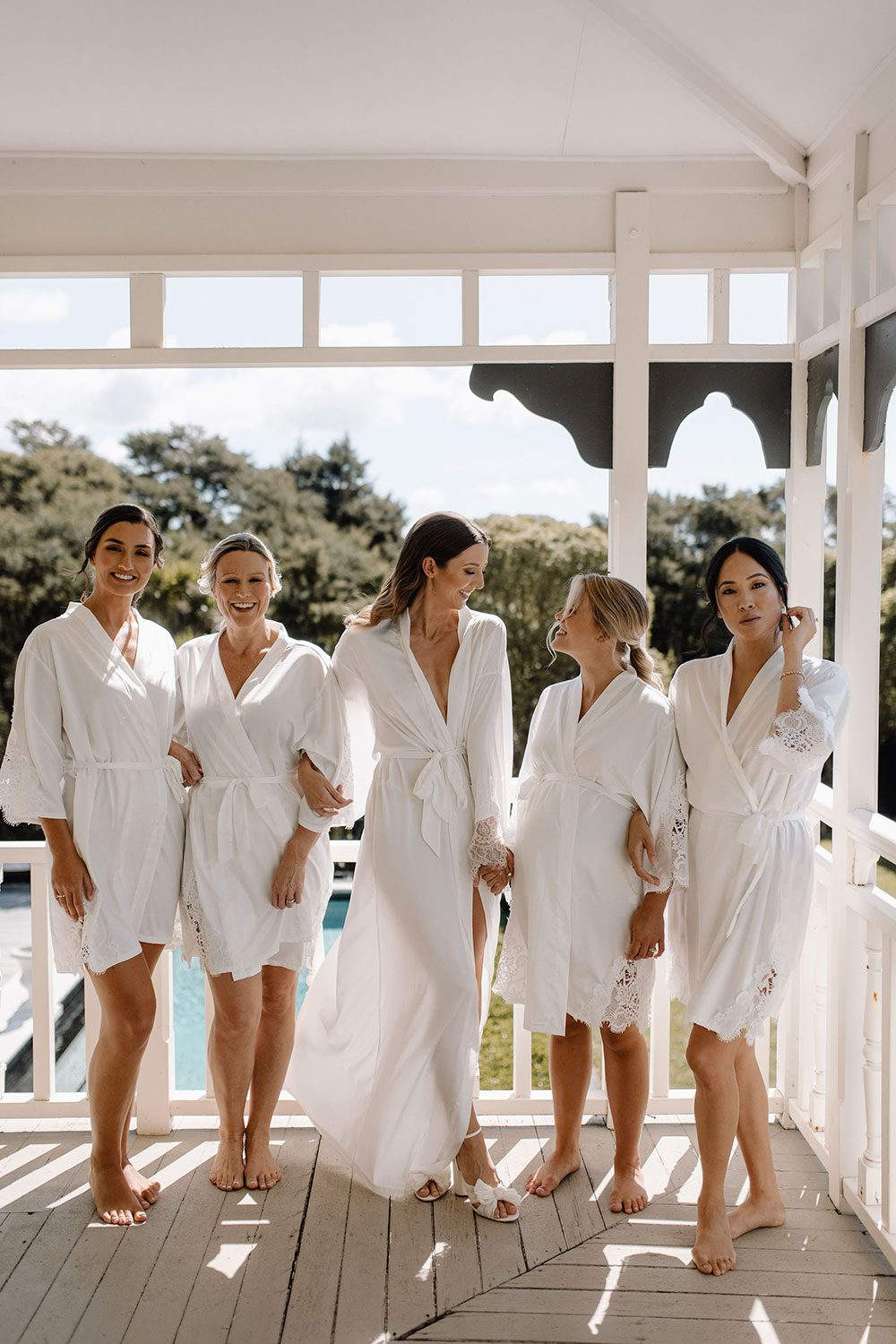 Steph and Owen - bride and bridesmaids in dressing gowns