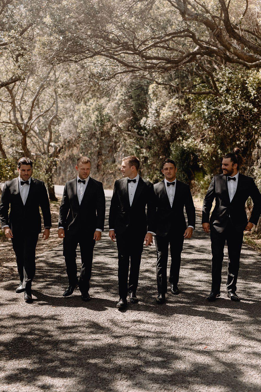 Steph and Owen - groom and groomsmen walking