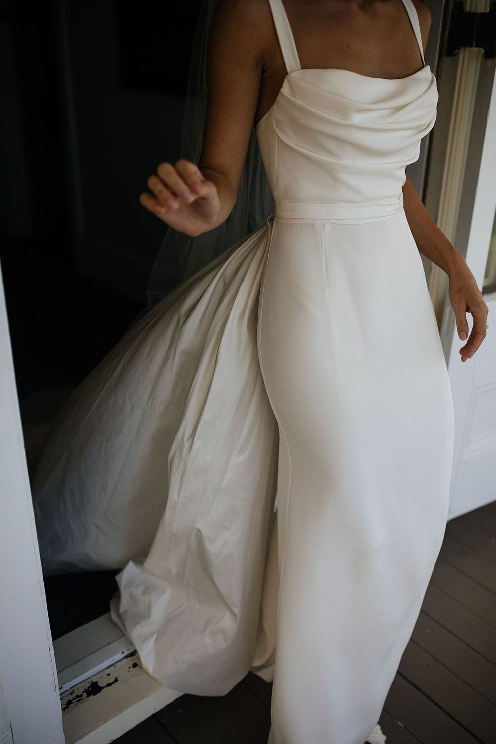 Bride wearing NZ Bespoke Bridal Gown made of silk faile with cowl bodice and detachable overskirt by Vinka Designs - front of dress